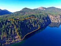 You will not find a more beautiful view of the Green Monarch Mountains than you'll find on this 13.75 acre Lake Pend Oreille waterfront parcel